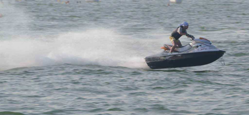 Fast shutter speed freezes jet-ski in air